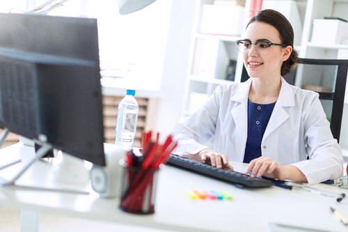 office manager live chats with patients on the computer